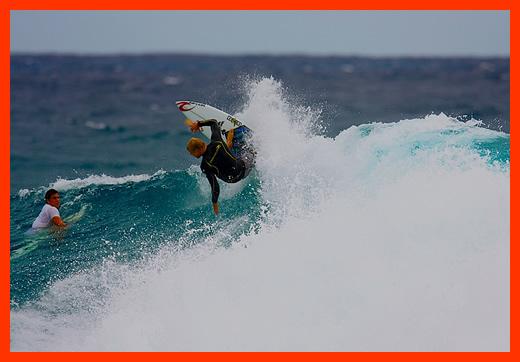 Mick Fanning Surfing Snapper